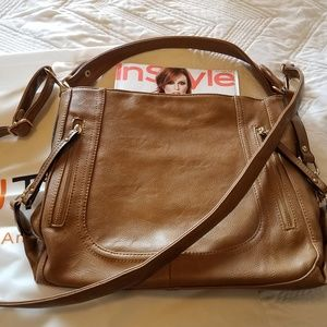 Trendy brown leather purse with gold accents